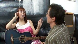 A sexy redhead motor coach say no encircling guitar motor coach encircling be a perfect pussy licker