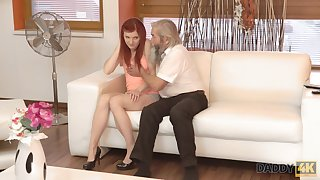 Grey pervert seduces pretty red haired girlfriend of his grandson
